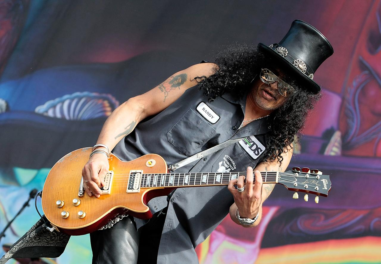 "Slash The long-haired guitarist accompanied Fergie for the 2011 halftime show. His real name? Saul Hudson. A family friend gave him the nickname ""Slash,"" because he was ""always in a hurry, zipping around from one thing to another."""