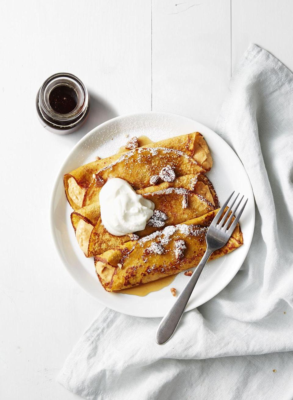 "<p>These pumpkin-cream cheese crêpes are spiked with maple syrup for the perfect fall dessert ... or even breakfast!</p><p><em><a href=""https://www.goodhousekeeping.com/food-recipes/a41238/pumpkin-cheesecake-crepes-recipe/"" rel=""nofollow noopener"" target=""_blank"" data-ylk=""slk:Get the recipe for Pumpkin Cheesecake Crêpes »"" class=""link rapid-noclick-resp"">Get the recipe for Pumpkin Cheesecake Crêpes »</a></em> </p>"