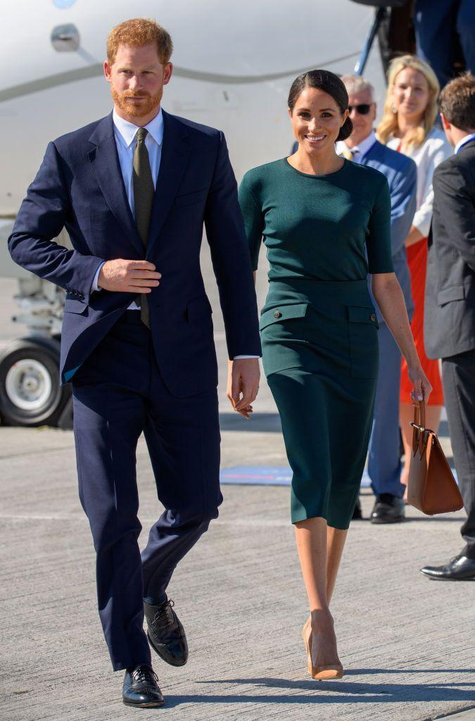 """<p>The royals have arrived in Dublin! <a href=""""https://www.townandcountrymag.com/style/fashion-trends/a22104648/meghan-markle-green-outfit-dublin-royal-visit-2018/"""" rel=""""nofollow noopener"""" target=""""_blank"""" data-ylk=""""slk:Meghan wore an appropriately green ensemble by Givenchy"""" class=""""link rapid-noclick-resp"""">Meghan wore an appropriately green ensemble by Givenchy</a> with a Strathberry Midi Tote and sleek low bun for her trip to Ireland, where she and Harry are on a royal visit. </p>"""