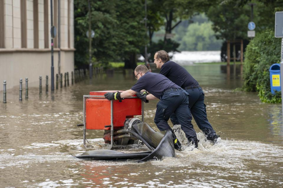 Firefighters pump water from the streets in Ruhr, Germany, on Thursday.