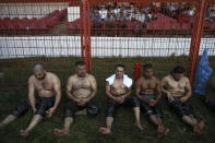 Exhausted wrestlers rest after they competed on the second day of the 660th instalment of the annual Historic Kirkpinar Oil Wrestling championship, in Edirne, northwestern Turkey, Saturday, July 10, 2021.Thousands of Turkish wrestling fans flocked to the country's Greek border province to watch the championship of the sport that dates to the 14th century, after last year's contest was cancelled due to the coronavirus pandemic. The festival, one of the world's oldest wrestling events, was listed as an intangible cultural heritage event by UNESCO in 2010. (AP Photo/Emrah Gurel)