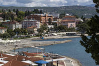 General view of the seafront and hotels in Opatija, Croatia, Saturday, May 15, 2021. Croatia has opened its stunning Adriatic coastline for foreign tourists after a year of depressing coronavirus lockdowns and restrictions. (AP Photo/Darko Bandic)