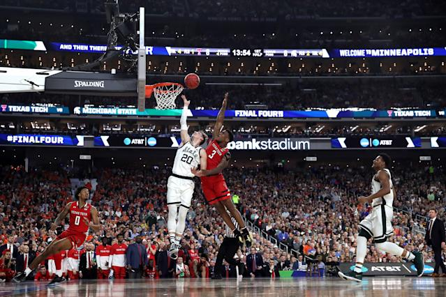 Matt McQuaid #20 of the Michigan State Spartans shoots the ball against Deshawn Corprew #3 of the Texas Tech Red Raiders in the first half during the 2019 NCAA Final Four semifinal at U.S. Bank Stadium on April 6, 2019 in Minneapolis, Minnesota. (Photo by Tom Pennington/Getty Images)