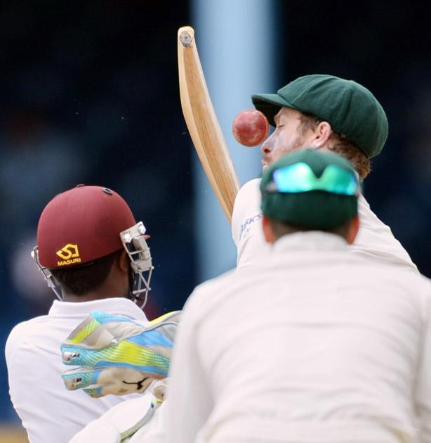 Australian wicketkeeper Peter Nevill (R) just misses a ball from West Indies batsman Narsingh Deonarine (L) during the third day of the second-of-three Test matches between Australia and West Indies April 17, 2012 at Queen's Park Oval in Port of Spain, Trinidad. AFP PHOTO/Stan HONDA (Photo credit should read STAN HONDA/AFP/Getty Images)