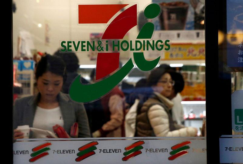 FILE PHOTO: People are seen at Seven & i Holdings Co's Seven Eleven convenience store in Tokyo