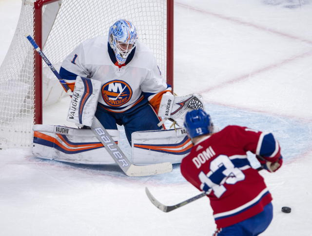 New York Islanders goaltender Thomas Greiss (1) makes the save on Montreal Canadiens centre Max Domi (13) during first period NHL hockey action Tuesday, Dec. 3, 2019 in Montreal. (Ryan Remiorz/The Canadian Press via AP)