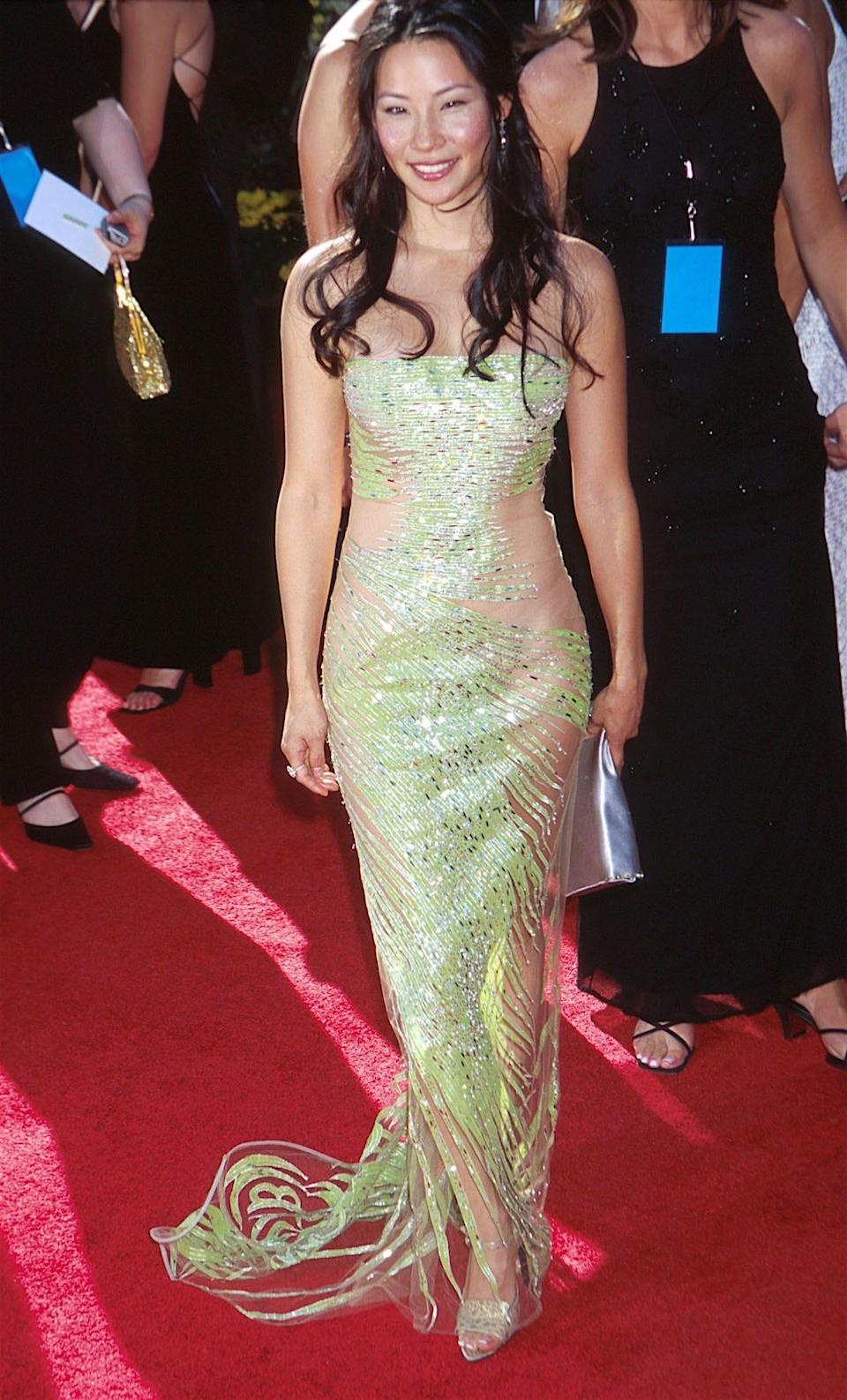 Lucy Liu wears a green partially sheer gown at the Emmys in 2000.