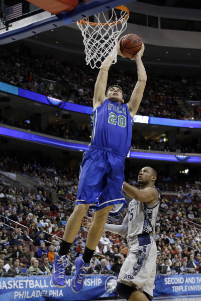 Florida Gulf Coast's Chase Fieler goes up for a dunk against Georgetown's Jabril Trawick during the second half of a second-round game of the NCAA college basketball tournament, Friday, March 22, 2013, in Philadelphia. (AP Photo/Matt Rourke)