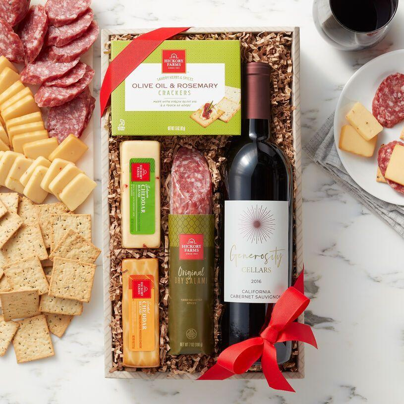 """<p>hickoryfarms.com</p><p><a href=""""https://go.redirectingat.com?id=74968X1596630&url=https%3A%2F%2Fwww.hickoryfarms.com%2Fgift-baskets%2Fwine%2Fwine-and-savory-snack-collection-002646.html&sref=https%3A%2F%2Fwww.townandcountrymag.com%2Fleisure%2Fdining%2Fg29328884%2Fbest-wine-cheese-gift-baskets%2F"""" rel=""""nofollow noopener"""" target=""""_blank"""" data-ylk=""""slk:Shop Now"""" class=""""link rapid-noclick-resp"""">Shop Now</a></p><p>California Cabernet Sauvignon, salami, olive oil and rosemary crackers, and two kinds of cheddar (jalapeno and smoked)? Now that's our idea of an afternoon snack! </p>"""