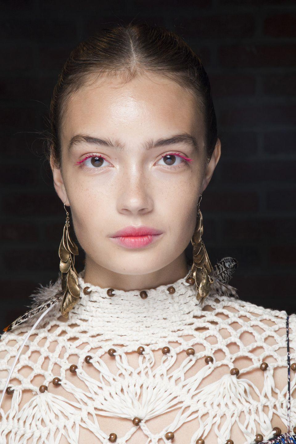 <p>Pair bare skin with fluoro pink lashes and matching watercolour lips for a modern take on date night make-up.</p>
