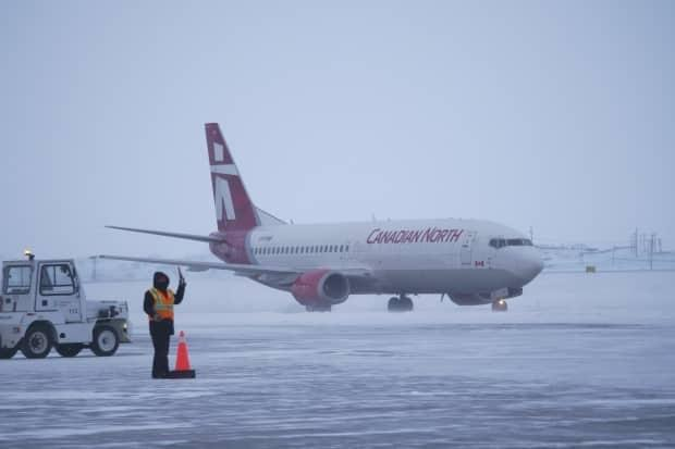 A Canadian North Flight lands on the tarmac in Iqaluit, Dec. 30, carrying Nunavut's first doses of the Moderna COVID-19 vaccine.