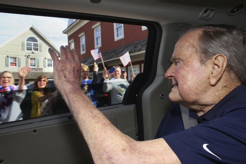 In this Sunday, May 20, 2018 photo provided by the office of former  President George H.W. Bush, the former president waves to supporters as his  motorcade ...