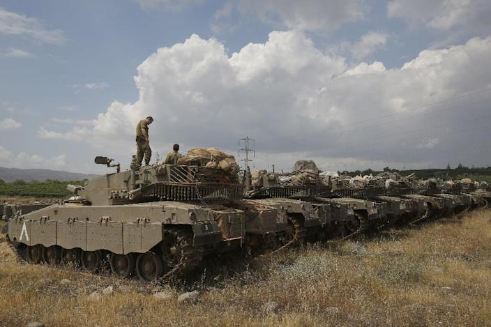 Israeli Merkava Mark IV tanks take position near the Syrian border in the Israeli-annexed Golan Heights on May 9, 2018 amid rising tensions on the frontier (AFP Photo/JALAA MAREY, JALAA MAREY)