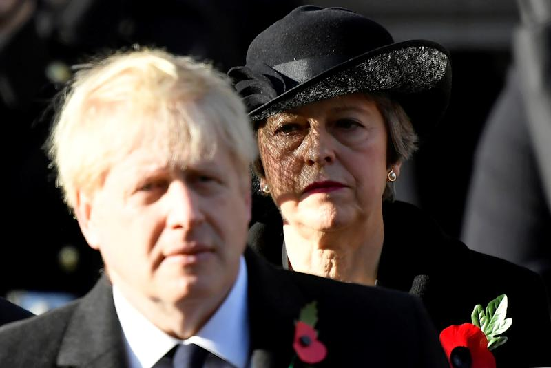 Britain's Prime Minister Boris Johnson and former PM Theresa May attend a National Service of Remembrance at The Cenotaph in Westminster, London, Britain, November 10, 2019. REUTERS/Toby Melville TPX IMAGES OF THE DAY