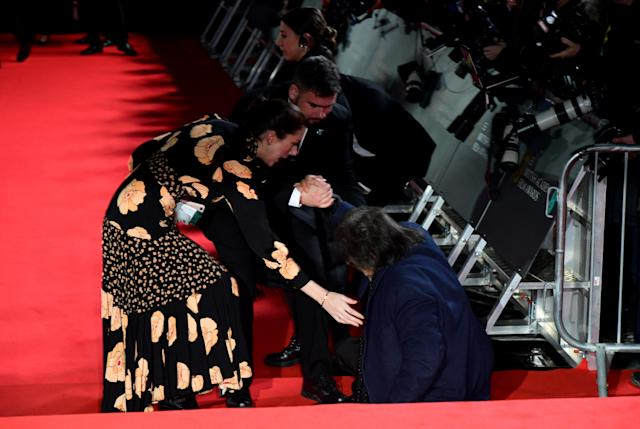 Al Pacino is helped to his feet after falling over whilst attending the 73rd British Academy Film Awards held at the Royal Albert Hall, London. (Photo by Ian West/PA Images via Getty Images)