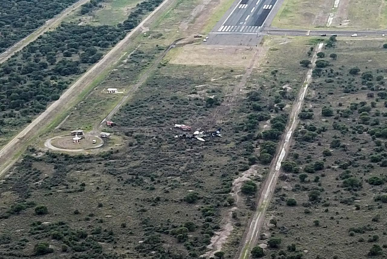<p>Picture showing the wreckage of a plane (C) that crashed with 97 passengers and four crew on board on take off at the airport of Durango, in northern Mexico, on July 31, 2018. – Dozens of Picture showing the wreckage of a plane (C) that crashed with 97 passengers and four crew on board on take off at the airport of Durango, in northern Mexico, on July 31, 2018. (Photo: Kevin Alcantar/Kevin Alcantar Drones Durango/AFP/Getty Images) </p>