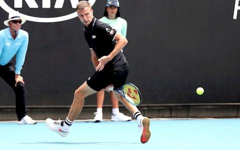 Hungary's Marton Fucsovics plays a shot between legs as he plays against Tommy Paul of the U.S. in their third round singles match at the Australian Open tennis championship in Melbourne, Australia