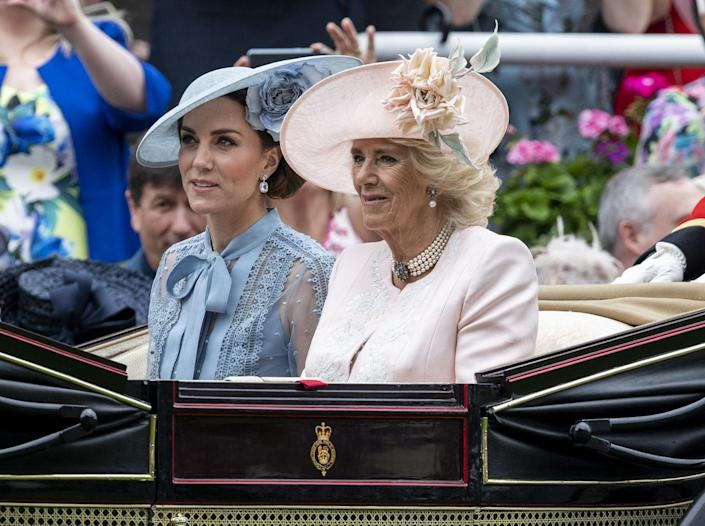 <p>For the first day of the 2019 Royal Ascot, Camilla opted for a soft pink ensemble. The jacket was embroidered with white florals and accented with one of her go-to jewelry pieces, the pearl and rose topaz choker. A matching blush hat with a floral accent completed the style. </p>