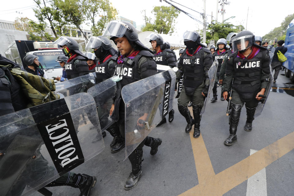 Police in riot gear deployed to disperse pro-democracy demonstrators near the Parliament in Bangkok, Tuesday, Nov. 17, 2020. Thailand's political battleground shifted to the country's Parliament Tuesday, where lawmakers are considering proposals to amend the country's constitution, one of the core demands of the student-led pro-democracy movement. (AP Photo/Sakchai Lalit)