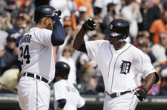 Detroit Tigers' Torii Hunter, right, is congratulated by teammate Miguel Cabrera on his solo home run off Baltimore Orioles starting pitcher Chris Tillman during the fourth inning of a baseball game in Detroit, Sunday, April 6, 2014. (AP Photo/Carlos Osorio)
