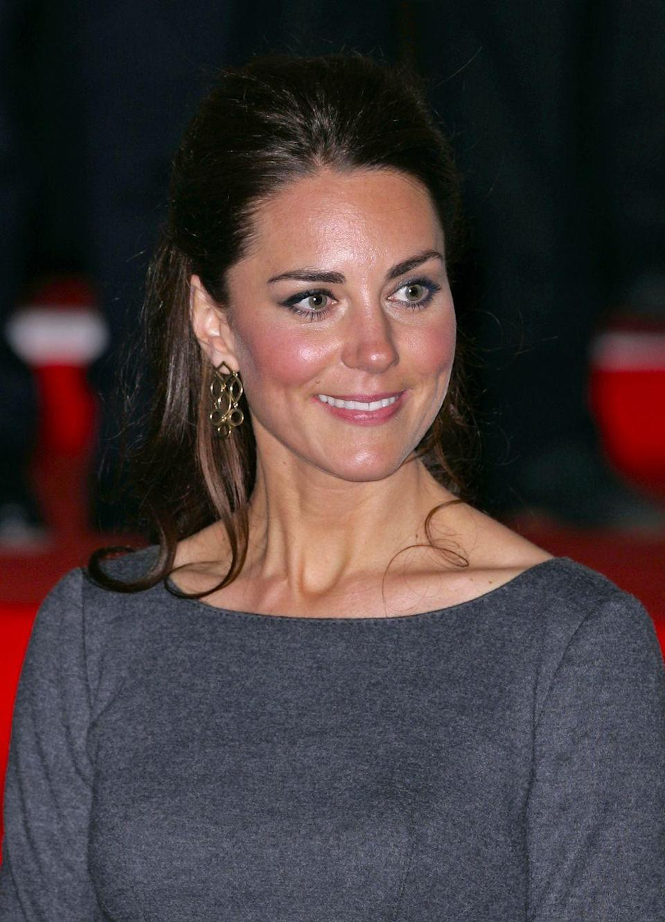 <p>Kate Middleton sported a pair of geometric gold earrings during a visit to London's Imperial War Museum in April 2012. </p>