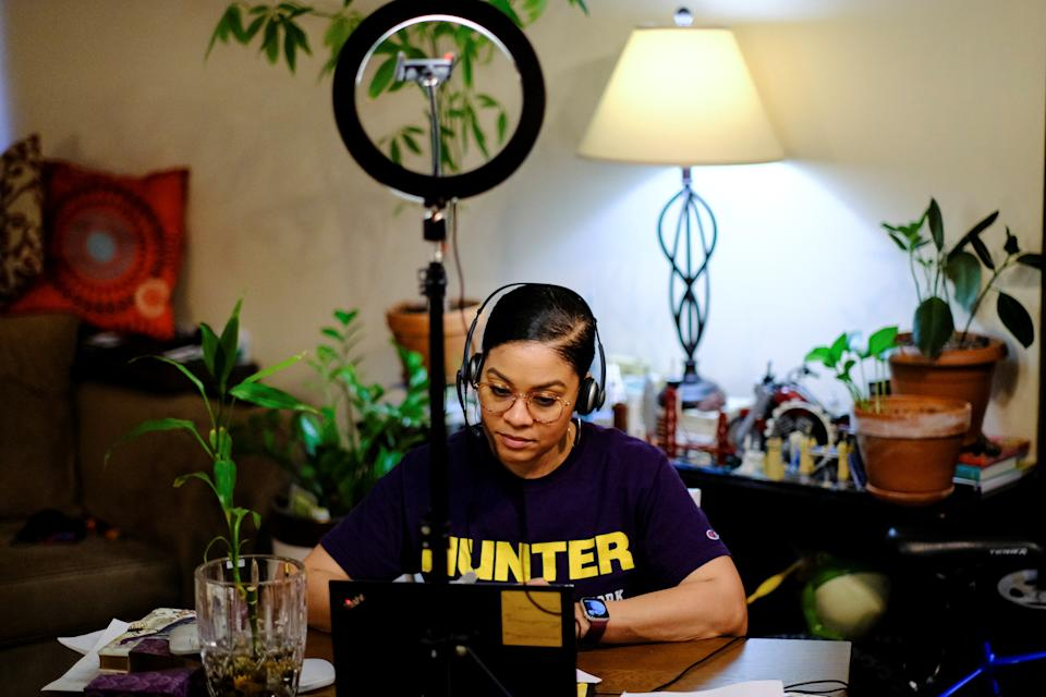 Amina Woods, program director for a foster care agency and a psychotherapist for a private practice, works at her home in New York City, U.S., March 3, 2021.