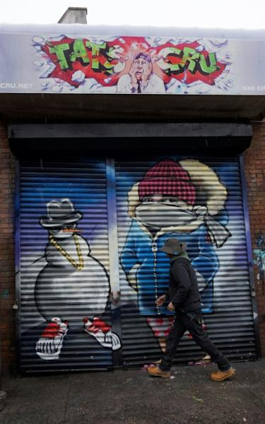 A worker with TATS CRU closes a storage locker at The Point in the Bronx borough of New York