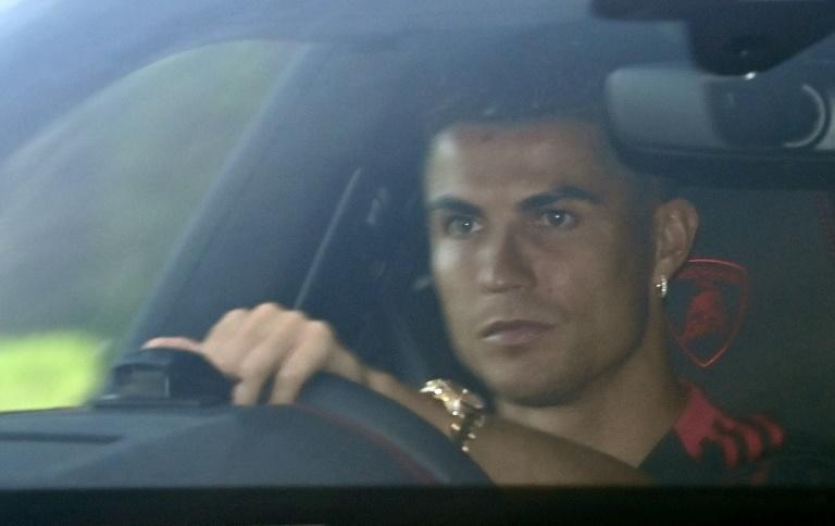 Cristiano Ronaldo leaves after a training session at Manchester United (AFP/Paul ELLIS)