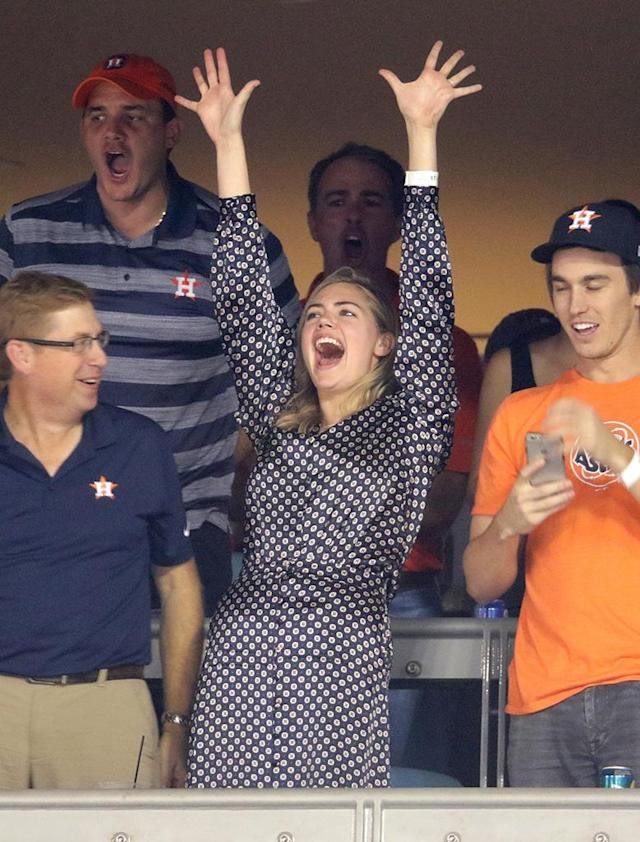 <p>His biggest fan! The model cheered on her fiancè, Houston Astros pitcher Justin Verlander, and celebrated as the team beat the Dodgers on Wednesday to tie the World Series at one game apiece. (Photo: Jerritt Clark/Getty Images) </p>