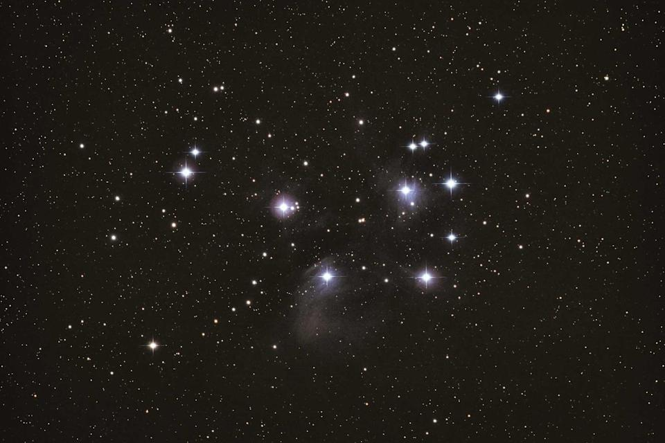 The stars cluster The Pleiades, M45 (Messier 45) taken from France and viewed like in binoculars. M45 is in the constellation of Taurus.