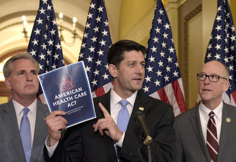 House Speaker Paul Ryan of Wis., center, standing with Energy and Commerce Committee Chairman Greg Walden, R-Ore., right, and House Majority Whip Kevin McCarthy, R-Calif., left, speaks during a news conference on the American Health Care Act on Capitol Hill in Washington, Tuesday, March 7, 2017. (AP Photo/Susan Walsh)