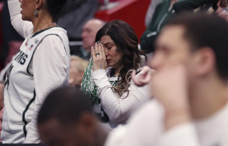 A Michigan State fan reacts late in the second half of the team's game against Syracuse in the second round of the NCAA men's college basketball tournament Sunday, March 18, 2018, in Detroit. Syracuse won 55-53. (AP Photo/Carlos Osorio)