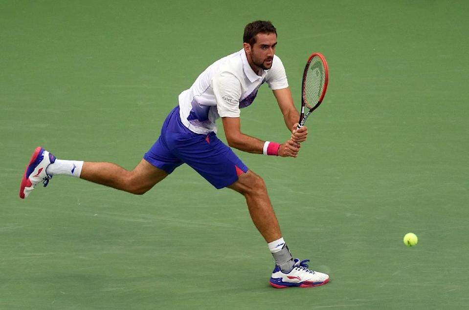 Marin Cilic hits a return to Novak Djokovic during their US Open 2015 men's semifinals match on September 11, 2015 in New York (AFP Photo/Don Emmert)