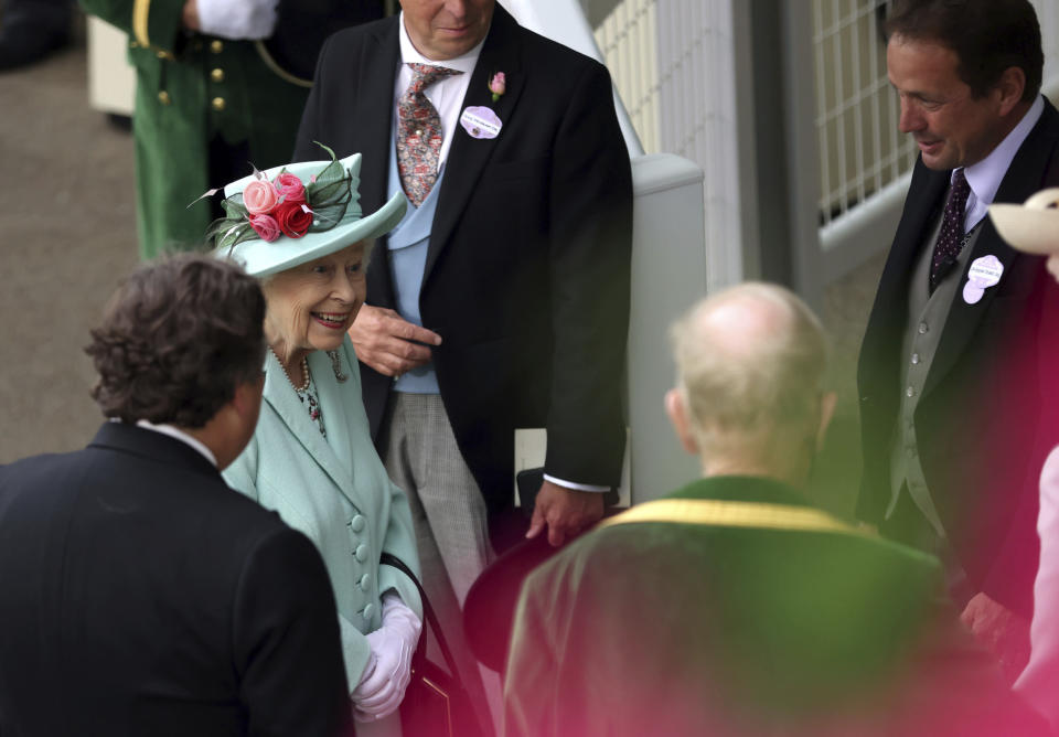 Britain's Queen Elizabeth II speaks to Sir Francis Brooke, left and other racegoers, during day five of of the Royal Ascot horserace meeting, at Ascot Racecourse, in Ascot, England, Saturday June 19, 2021. (Steven Paston/PA via AP)
