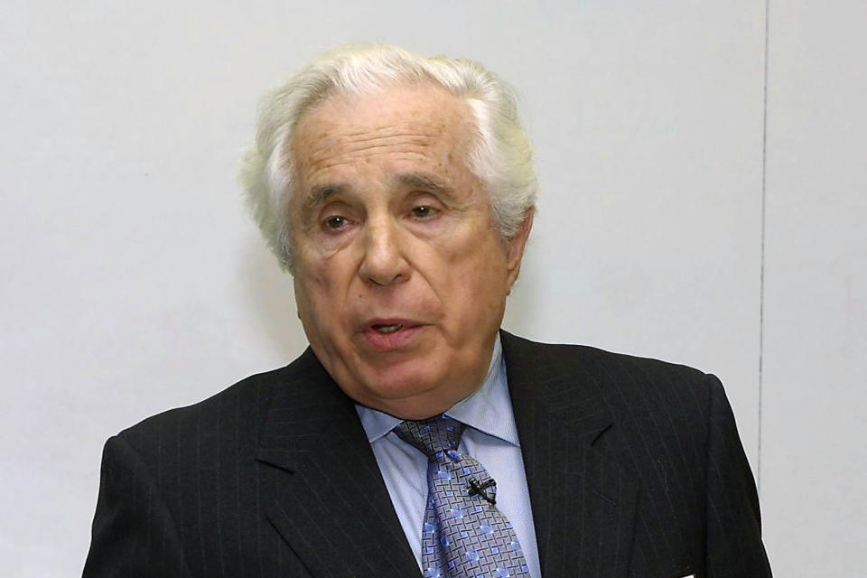 "FILE - Seymour Topping, Pulitzer board administrator, speaks at the Graduate School of Journalism of Columbia University in New York, in this March 4, 2002, file photo. Topping, among the most accomplished foreign correspondents of his generation for The Associated Press and the New York Times and later a top editor at the Times and administrator of the Pulitzer Prizes, died on Sunday, Nov. 8, 2020, in White Plains, N.Y. He was 99. Topping passed away ""peacefully"" at White Plains Hospital, his daughter Rebecca said in an emailed statement. (AP Photo/David Karp, File)"