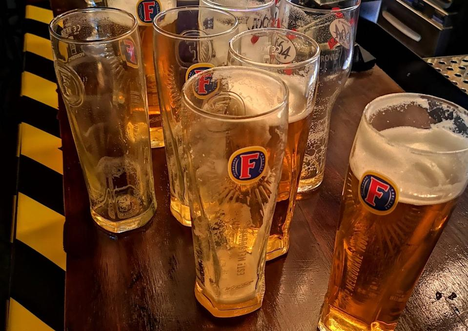 Officers posted a picture of the pint glasses after breaking up a gathering in a pub in Dalston. (Met Police)