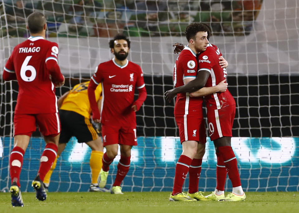 Liverpool's Diogo Jota (second from right) celebrates scoring their first goal with Sadio Mane.