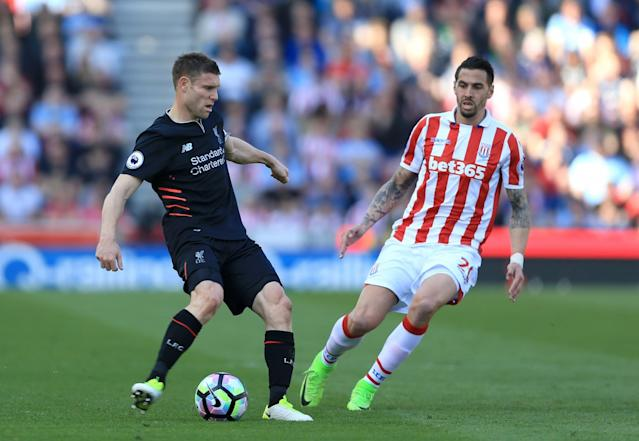 <p>James Milner clears the danger for Liverpool</p>