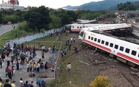 <span>The train fell in a zig-zag shape</span> <span>Credit: CNA PHOTO/AFP/Getty Images </span>