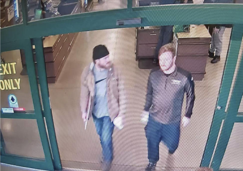 """This image from a Jan. 1, 2020 surveillance video and released in a U.S. Attorney detention memorandum, shows Brian Mark Lemley Jr, right, and Patrik Mathews leaving a store in Delaware where they purchased ammunition and paper shooting targets. The pair, along with William Garfield Bilbrough IV,  plotted to carry out """"essentially a paramilitary strike"""" at a Virginia gun rights rally, a federal prosecutor said Wednesday, Jan. 22, 2020. FBI agents arrested Mathews, Lemley and Bilbrough on Jan., 16, as part of a broader investigation of The Base, a white supremacist group.  (U.S. Attorney via AP)"""