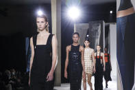 Models wear creations for the Hermes Spring-Summer 2021 fashion collection, Saturday, Oct. 3, 2020, during Paris fashion week. (Photo by Vianney Le Caer/Invision/AP)