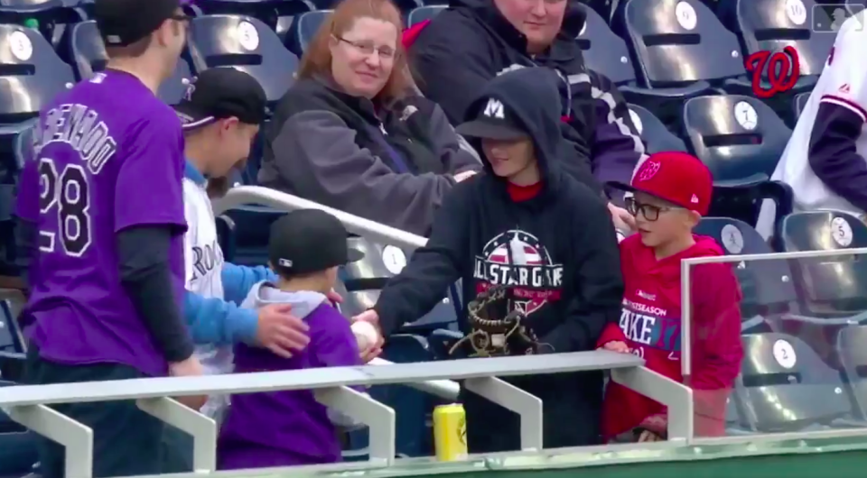 Two young baseball fans made a pretty solid trade after catching home run balls Sunday. (Screenshot via @Rockies on Twitter)