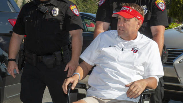 Liberty head football coach Hugh Freeze arrives to the stadium in a wheelchair last Saturday. (AP Photo/Matt Bell)