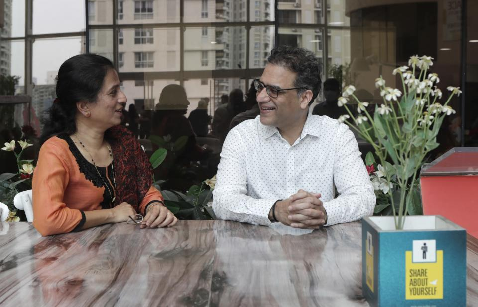 Dr. Kedar Toraskar, head of critical care, right, catches up with his wife Dr. Nameeta Toraskar, who works in a different hospital at the cafeteria of Mumbai Central Wockhardt Hospital in Mumbai, India, June 5, 2021. The recent coronavirus surge in India affected young people on a scale his team of critical care doctors hadn't previously seen. Toraskar and his team of ICU doctors are still drained from the incredibly challenging last few months. (AP Photo/Rajanish Kakade)