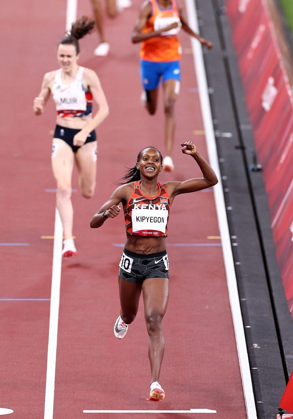 <p>Faith Kipyegon of Team Kenya reacts after winning the gold medal during the Women's 1500m Final. </p>