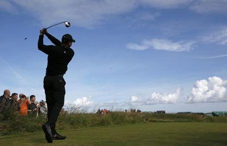 Tiger Woods of the U.S. watches his tee shot on the 12th hole during a practice round ahead of the British Open Championship at the Royal Liverpool Golf Club in Hoylake, northern England July 15, 2014. REUTERS/Stefan Wermuth
