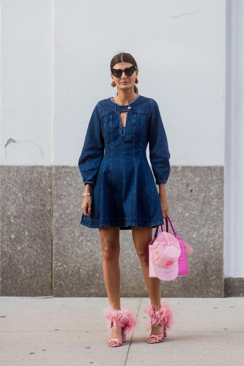 <p>Lessons in how to make denim look glamorous, she paired a skater dress with Barbie pink accessories in September 2017.</p>