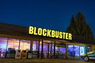 """<p>Ah, Blockbuster. Let's take it back to those Friday nights we spent endlessly wandering the aisles of the video store, searching for the <a href=""""https://www.menshealth.com/entertainment/a35550881/jason-blum-favorite-horror-movies/"""" rel=""""nofollow noopener"""" target=""""_blank"""" data-ylk=""""slk:best horror movies"""" class=""""link rapid-noclick-resp"""">best horror movies</a> to enjoy while cuddling up for a scary movie marathon, or finding a good <a href=""""https://www.menshealth.com/entertainment/g22624990/best-tom-cruise-movies/"""" rel=""""nofollow noopener"""" target=""""_blank"""" data-ylk=""""slk:Tom Cruise action flick"""" class=""""link rapid-noclick-resp"""">Tom Cruise action flick</a> to watch while chowing down on some popcorn and Twizzlers. Whatever you were looking for, Blockbuster video had it... unless someone had already rented it out. Then you were stuck playing the waiting game. And don't forget about the due date because the last thing you wanted to incur were those pesky fees on a late movie return. But that was all a part of the video store experience that is lost upon the endless scrolling on Netflix. </p><p>Out of <a href=""""https://www.menshealth.com/trending-news/g35658504/iconic-stores-no-longer-around/"""" rel=""""nofollow noopener"""" target=""""_blank"""" data-ylk=""""slk:all the stores that no longer exist"""" class=""""link rapid-noclick-resp"""">all the stores that no longer exist</a>, Blockbuster video stores reign supreme on that sweet, sweet nostalgia factor. So much so, in fact, that it was the subject to the documentary <em><a href=""""https://www.imdb.com/title/tt8704802/"""" rel=""""nofollow noopener"""" target=""""_blank"""" data-ylk=""""slk:The Last Blockbuster"""" class=""""link rapid-noclick-resp"""">The Last Blockbuster</a></em>, which chronicled the rise and fall of everyone's favorite video store and shined a spotlight on the last Blockbuster on earth (yep, <a href=""""https://bendblockbuster.com"""" rel=""""nofollow noopener"""" target=""""_blank"""" data-ylk=""""slk:there's still one single location left"""" class=""""link rapid-noclick-resp"""">t"""