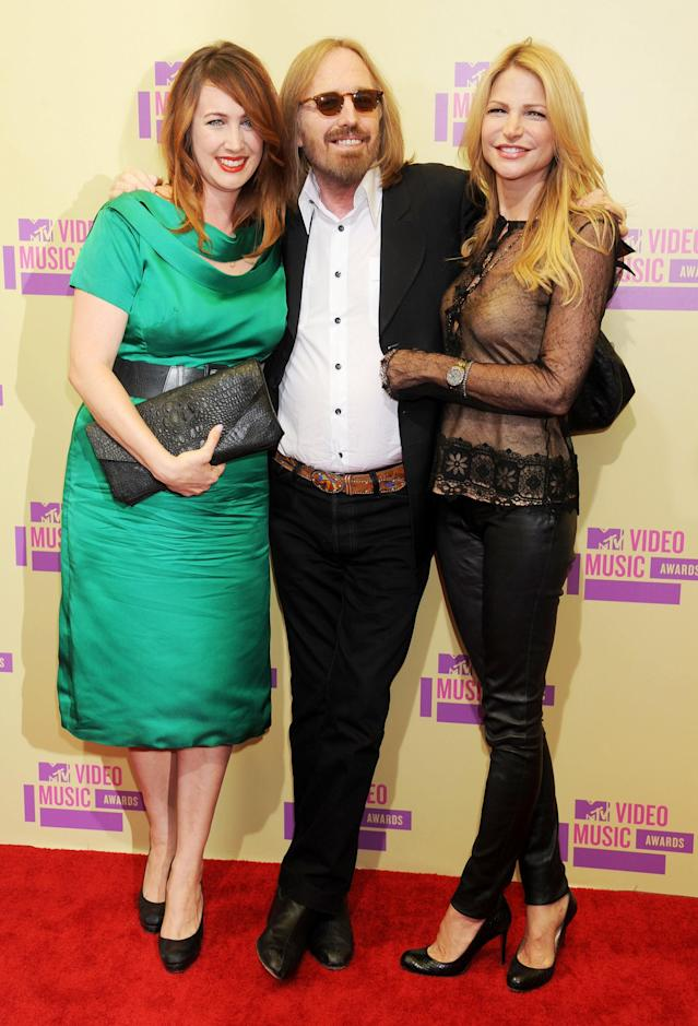 <p>Tom Petty, with daughter Adria Petty, left, and wife Dana Petty, arrives at the 2012 MTV Video Awards in Los Angeles, Sept. 6, 2012. (Photo: Gregg DeGuire/Getty Images) </p>