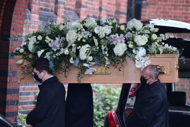 Dame Barbara Windsor's coffin is carried into Golders Green Crematorium, north London, ahead of a private ceremony
